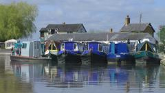 Canal Boats reflected in water Stock Footage