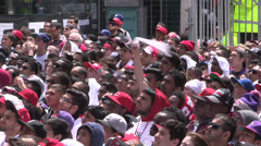Toronto sports fans watch game outside during playoffs Stock Footage