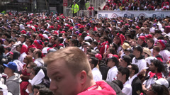 Toronto sports fans watch game outside during playoffs - stock footage