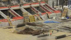 Sport arena, stadium construction, worker team are working, hard job, time lapse Stock Footage