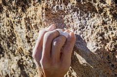 climber crimp grip - stock photo