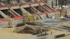 Sport arena, stadium construction, worker team are working, hard job Stock Footage