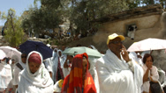 Stock Video Footage of 4K UHD Ethiopian Orthodox pilgrims at Deir es Sultan by the dome of St. Helena
