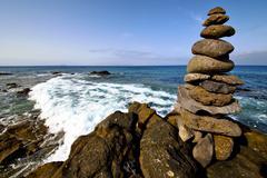 in lanzarote coastline  froth    rock stone sky cloud beach - stock photo