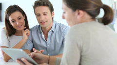 Couple meeting financial adviser in office Stock Footage