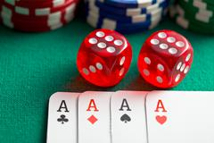 The red casino dice and poker cards Stock Photos