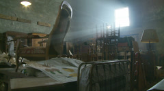 Rays of light enter a barn with furniture Stock Footage
