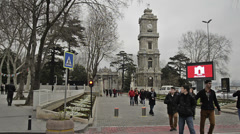 Clock tower, Dolmabahce, Istanbul, people walking front of the palace time lapse Stock Footage