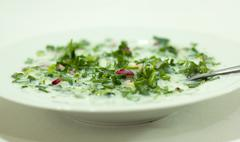 Salad of greens in yogurt - useful and healthy food. Stock Photos