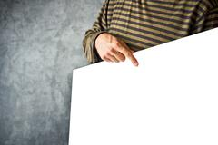 Man holding paper poster as copy space Stock Photos
