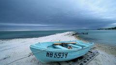 Old boat on the pier in background sea and cloudy sky Stock Footage