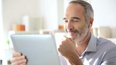 Businessman talking via internet with tablet Stock Footage