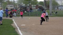 Girls softball hit and safe at first 4K 055 Stock Footage
