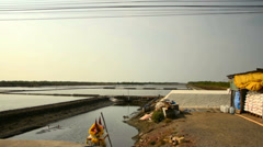 Salt harvesting along the highway in Thailand. Stock Footage
