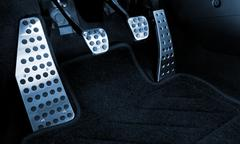 Sport car chrome pedals (toned in blue) Stock Photos