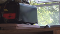 Toolshed with view of battery charger and window Stock Footage