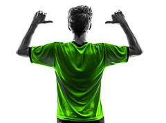 rear view portrait soccer football player young man pointing  silhouette - stock photo