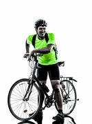 Man bicycling  mountain bike standing silhouette Stock Photos