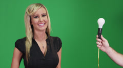 Woman modeling in front of a green screen with a light bulb Stock Footage