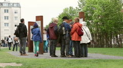 Tourists at Berlin Wall Memorial - stock footage