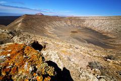 Vulcanic timanfaya  rock stone sky  lanzarote spain Stock Photos