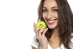 Health conscious woman about to eat fresh green apple Stock Photos
