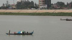Fisherman on Tonle Sap River along Phnom Penh Promenade Stock Footage