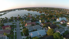 Suburban homes arial view at dusk Stock Footage