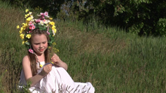 Little beautiful spring girl with a wreath of flowers on her head Stock Footage