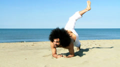 Italian fit male model playing on the beach posing on sand Stock Footage