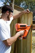 portable nail gun - stock photo