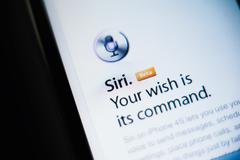 Siri voice command on apple smartphone and tablet Stock Photos
