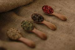 Pepper Blend spices small spoon on top sackcloth Stock Photos
