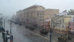 Military War Tanks and Trucks ride Moscow street in Snowstorm Fog. Stock Footage