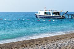 The motor yacht for diving is near pier, antalya, turkey Stock Photos