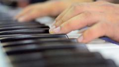 Two hands playing a gentle piece on a beautiful grand piano. a recording of t Stock Footage