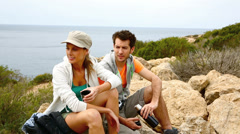 Couple having a break during hiking journey Stock Footage