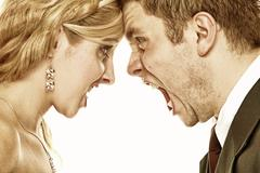 wedding fury couple yelling, relationship difficulties - stock photo