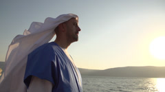Stock Video Footage of Man in Biblical Clothing on The Sea of Galilee
