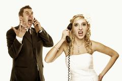 wedding fury couple phone yelling, relationship difficulties - stock photo
