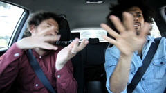 Two friends singing and shouting driving car happy - stock footage