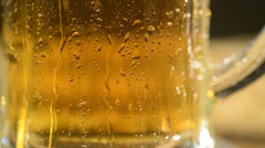 Stock Video Footage of detail of pint of beer, drops flowing down, locked down