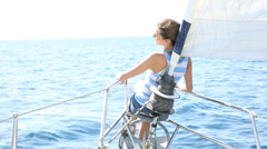 Woman sitting at boat bow while sailing Stock Footage