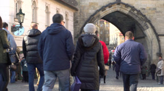 Pedestrians walking through city of Prague Stock Footage