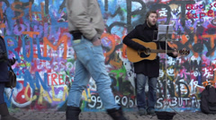 Performer in front of the Lennon wall in Prague Stock Footage