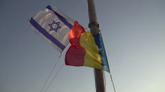 Flags of Israel and Romania Waving Stock Footage