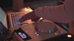 Deejay's hands playing set at party, nightclub atmosphere Stock Footage
