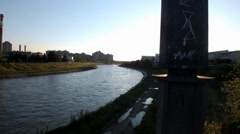 Beautiful view of the river Nisava, which quickly runs until lightly sun sets be - stock footage
