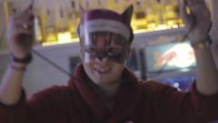 Young man wearing fancy mask, dancing, having fun in nightclub Stock Footage