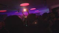 Dance floor in the nightclub, young men women partying, drinking - stock footage